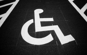 Disability claim parking signage